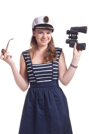 A girl in a sailor cap holding a pair of binoculars and a pipe for smoking on a white background Stock Photo - 9661409