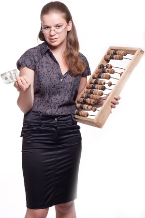 Girl with big wooden accounts and money on a white background photo