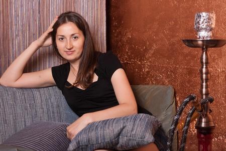 girl in a restaurant near the hookah Stock Photo