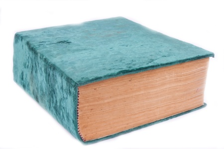 an old book in a green velvet with a white background Stock Photo - 9744360
