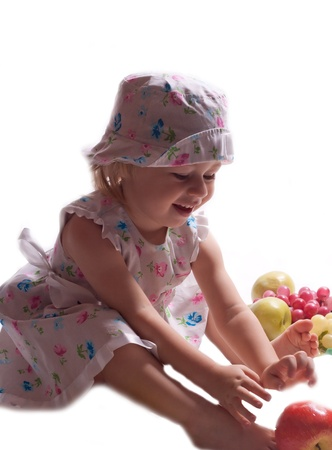 A child with fruit on a white background photo
