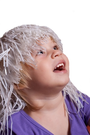 The little girl in a fake wig studio photography photo