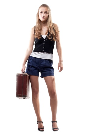 beautiful girl in shorts with a suitcase photo