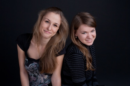 two friends talking and smiling studio shot Stock Photo