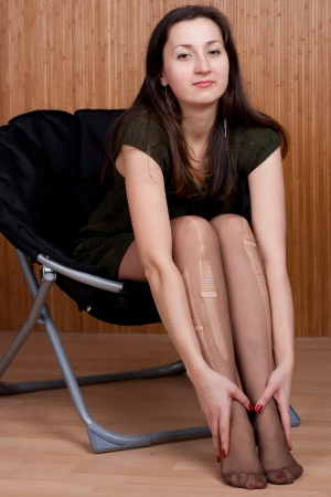 sad pensive girl in torn tights studio photography Stock Photo - 10098428