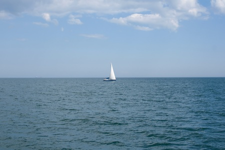 Lonely sailboat at sea photography photo