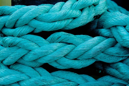 marine rope knotted blue pigtail Stock Photo