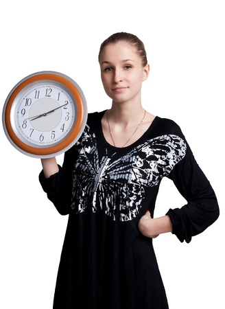 The girl with the big clock in the hands of studio shooting photo