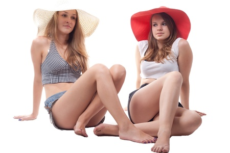 Two girls in summer hats studio photography photo