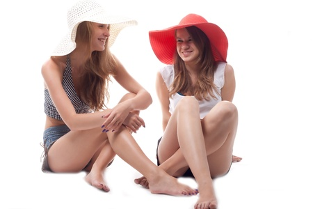 Two girls in summer hats studio photography Stock Photo - 10393981