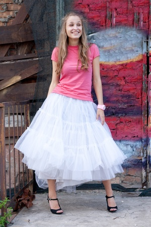 girl in white skirt and pink T-shirt in the city