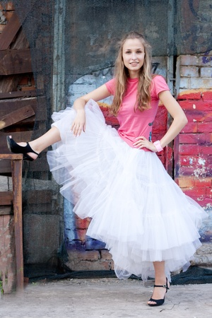 girl in white skirt and pink T-shirt in the city Stock Photo - 11116064