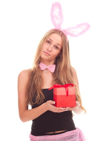 A girl dressed as a rabbit with gifts studio shooting photo