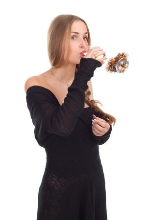 girl celebrates Christmas with a glass of wine studio shooting Stock Photo - 11003108