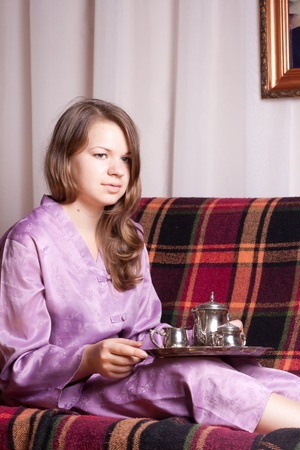 The girl in purple pajamas in the room photo