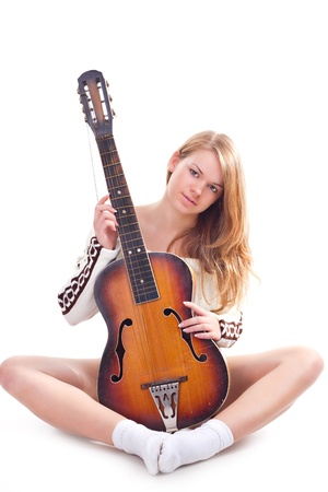 Beautiful girl in a sweater with a guitar studio photography photo