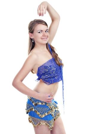 bellydancing: Girl dancing oriental dance in a blue suit studio shooting