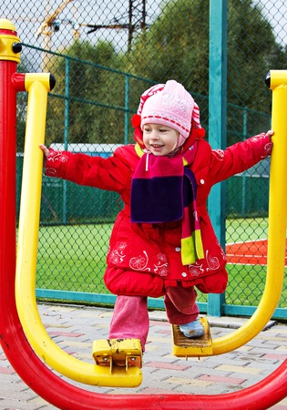 The little girl in winter clothing deals on fitness equipment outdoor shooting in the yard