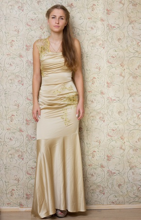 Beautiful sad girl in the dress photography studio photo