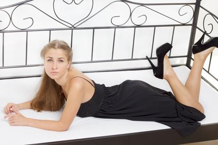 Beautiful girl lying on the bed studio photography Stock Photo - 13098465