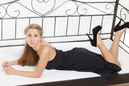 Beautiful girl lying on the bed studio photography Stock Photo - 13098465