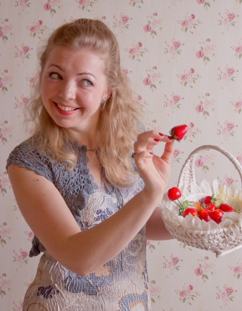 cute young woman with strawberry studio shoot photo