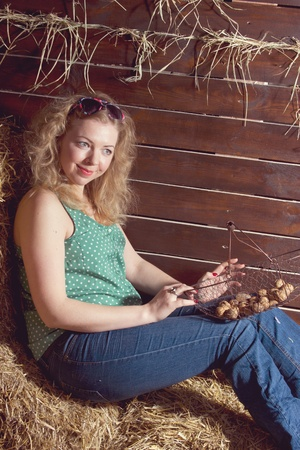 beautiful blonde smiling woman with basket on haystack studio shoot Stock Photo - 13278410