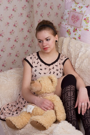 girl with teddy bear in bed studio shoot Stock Photo - 13457914