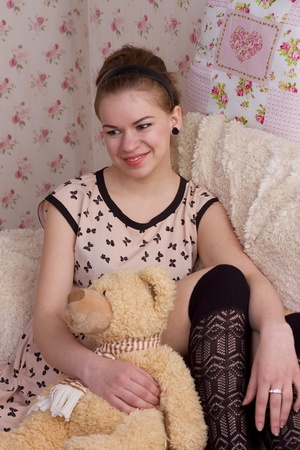 girl with teddy bear in bed studio shoot photo