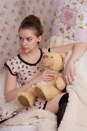 nightgown: girl with teddy bear in bed studio shoot