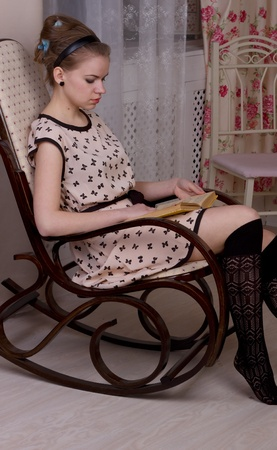 Relaxing  girl reading book in bloom studio shoot photo