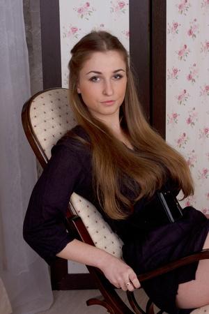 A girl in a high chair studio shoot