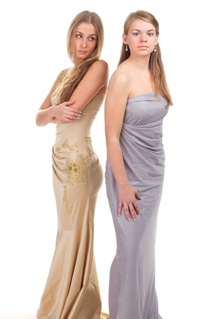 Hall envious friends - two girls in dresses with gold and silver on a white background