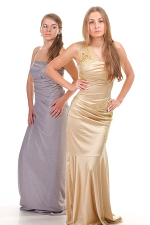 envious: Envy of her friends - two friends in the gold and silver dress on a white background