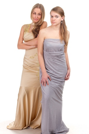 envious: Hall envious friends - two girls in dresses with gold and silver on a white background