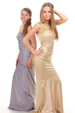 Envy of her friends - two friends in the gold and silver dress on a white background photo
