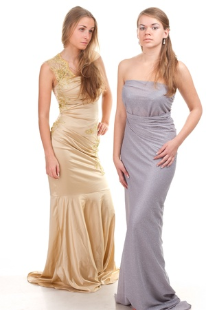 Hall envious friends - two girls in dresses with gold and silver on a white background photo