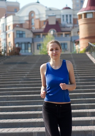 Young woman running and training in city streets Stock Photo - 13458526