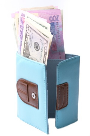 Blue purse with money - dollars and Ukrainian hryvnias on a white background photo