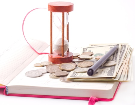 pen and coin on notebook on white background photo