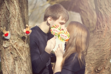Young couple having covered candy kisses photo