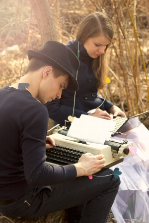 Young couple freelance typing on typewriter photo