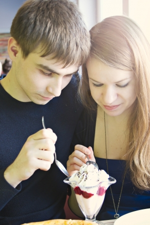 Closeup portrait of young cute couple at cafe photo