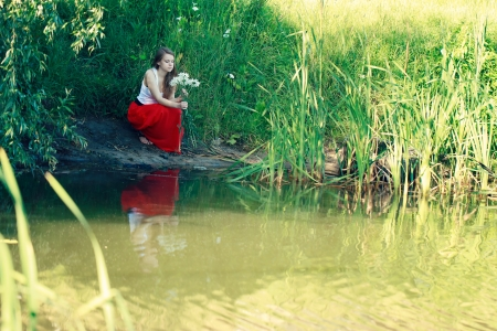 Beautiful girl in a long red skirt