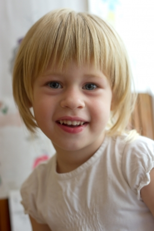 Little girl  smiles at the camera Stock Photo - 14378899