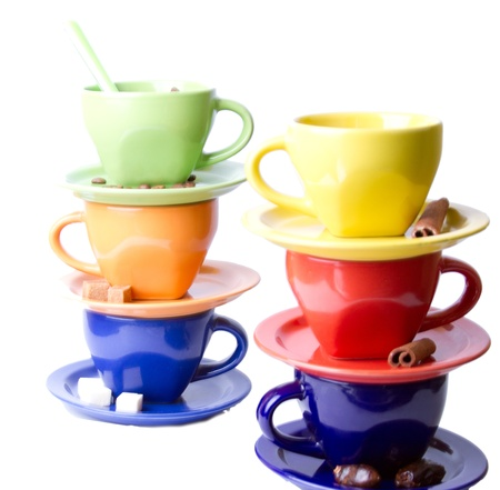 Colorful cups of coffee, sugar and cinnamon stick photo