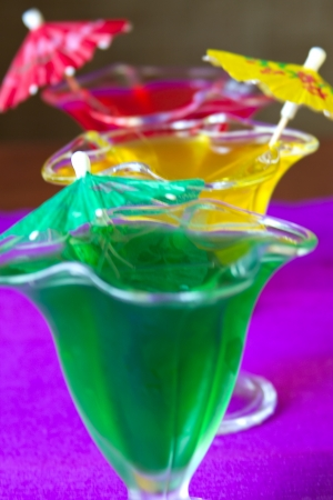 Glasses with colored jelly with paper umbrellas photo