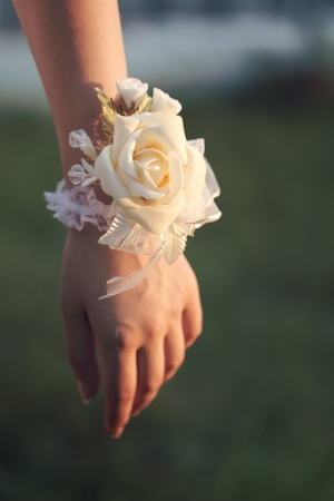Flower on hand of the bridesmaids at the wedding photo