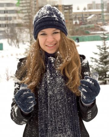 Happy teen girl with snow Standard-Bild