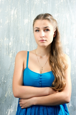 Portrait of a beautiful blonde girl in a blue dress Stock Photo - 15646889